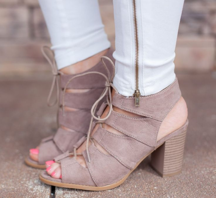 This trendy bootie features criss cross front detail with an open back. They first true to size and have a 3' heel