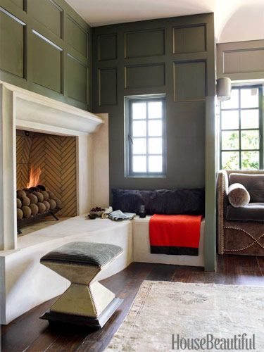 The husband's study with a limestone inglenook is hidden behind a panel off the living room. Orange blanket by Rani Arabella.