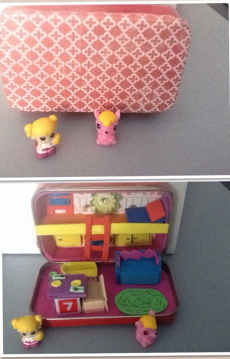 A home for  squinkie and pet. Made from altoid tin, fun foam, scrapbook paper and red ductape.