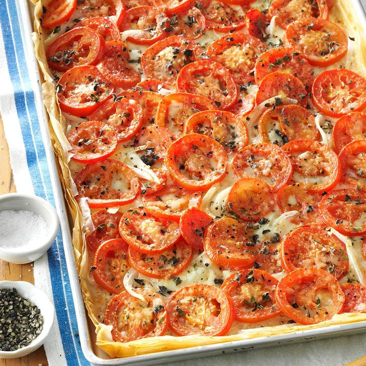 Tomato-Onion Phyllo Pizza Recipe -With a delicate crust and lots of lovely tomatoes on top, this dish is a special one to serve to guests. I make it often when fresh garden tomatoes are in season. It freezes well unbaked, so I can keep one on hand to pop in the oven for a quick dinner.—Neta Cohen, Bedford, Virginia