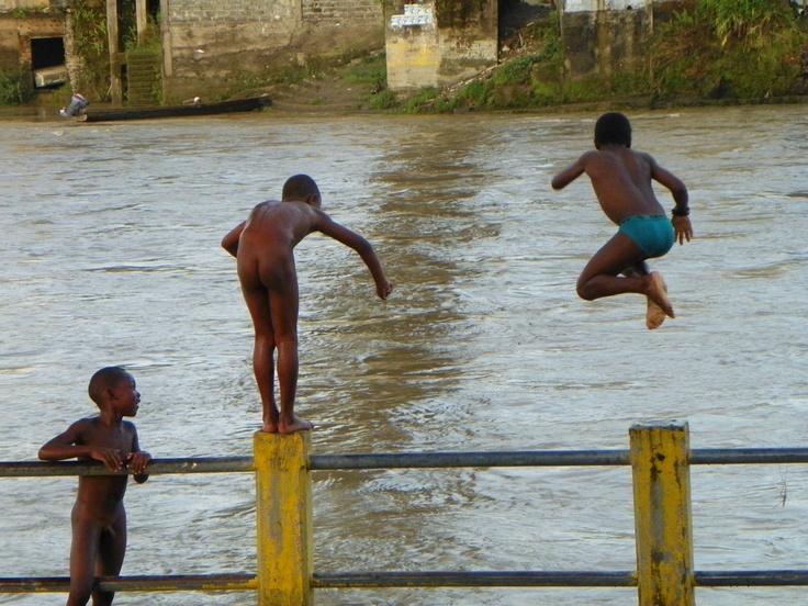 Boys swiming in the river.