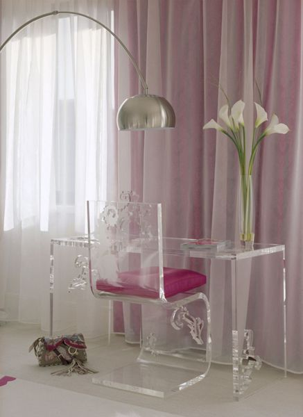 More Lucite! We love the way it provides useful solutions to a room without taking up visual space. This desk and chair are especially pretty with the design cut-outs.