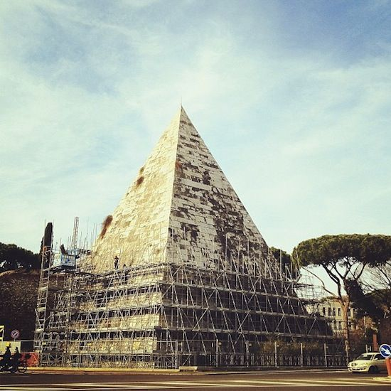 The Pyramid of C. Cestius is enevloped in scaffolding ahead of a year-long restoration project.