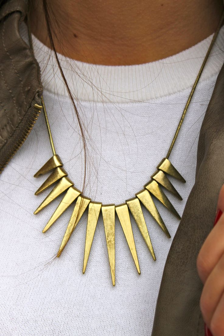 The rockin' Solar Flare Gold Necklace adds a touch of golden rays to your  dresses and cute tops. Cast triangular charms hang on a smooth round chain.