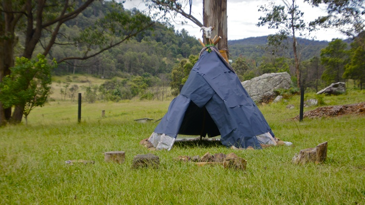 A Tee-pee I made for the kids here... Complete with small outdoor fireplace + tree trunk & sand stone  block stools...