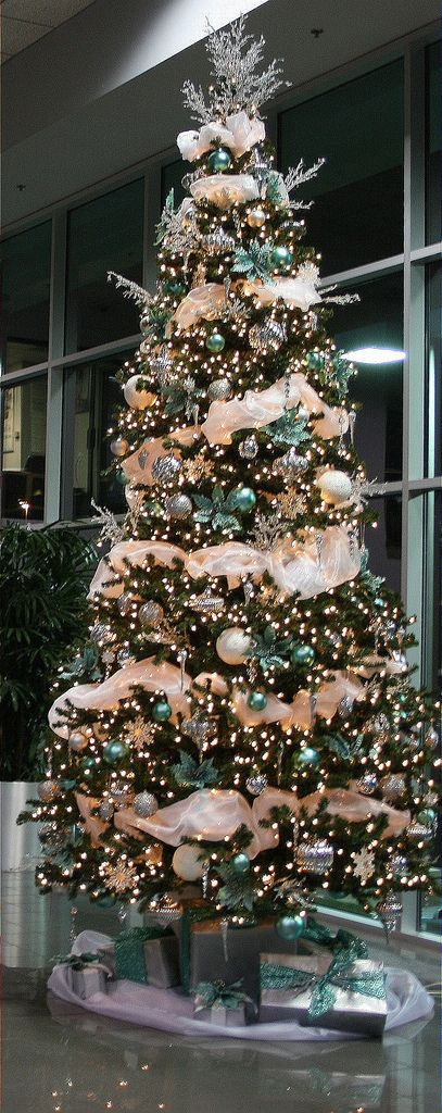 12ft Christmas Tree decorated with Tiffany Blue and Silver Ornaments as well as Crystals
