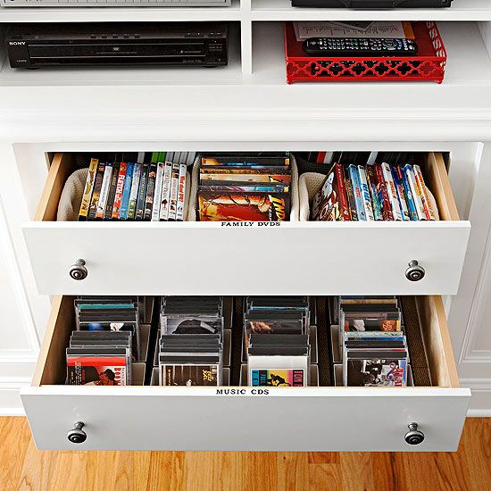 Media Station  The media center can quietly blend in or function with ease when it's time for a movie night or gaming competition. Small bins and boxes categorize DVDs, video games, and CDs. Adhesive labels on each drawer make searching a snap