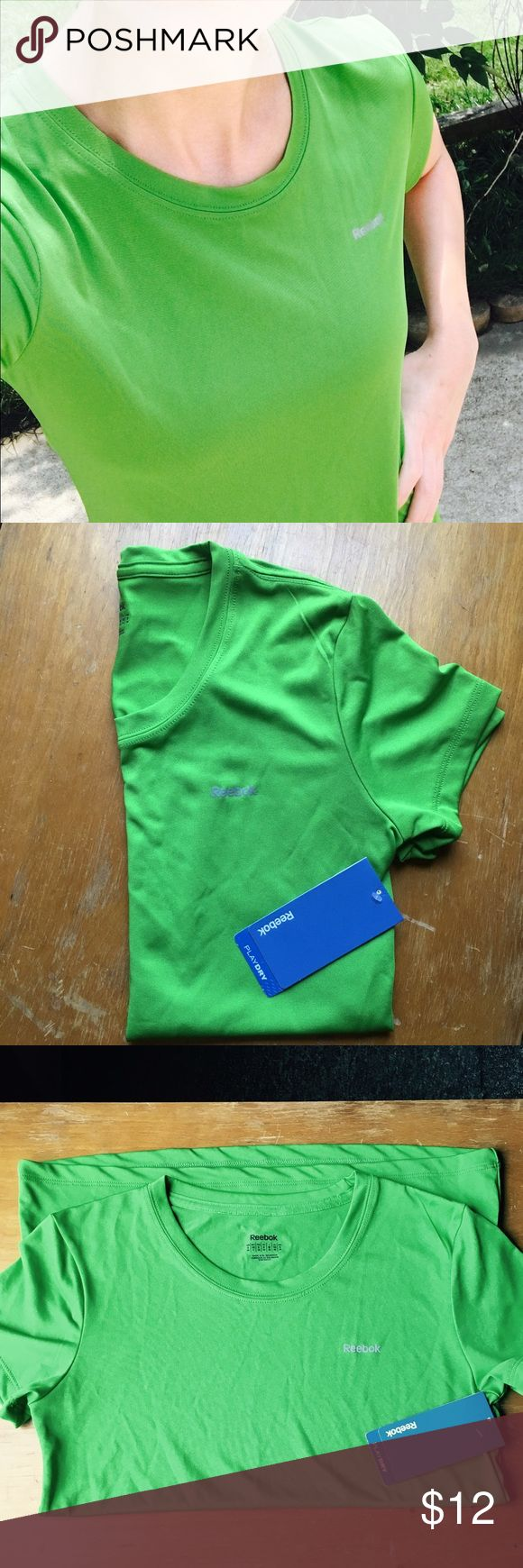 REDUCED FOR QUICK SALE Reebok Workout Tee This is a Reebok Workout Tee. It has a classic crew neck, and a slightly tapered torso, which is very flattering on. It's in a bright green color, which is represented well in the pictures above. NEVER WORN! STILL HAS TAGS ON! Reebok Tops Tees - Short Sleeve