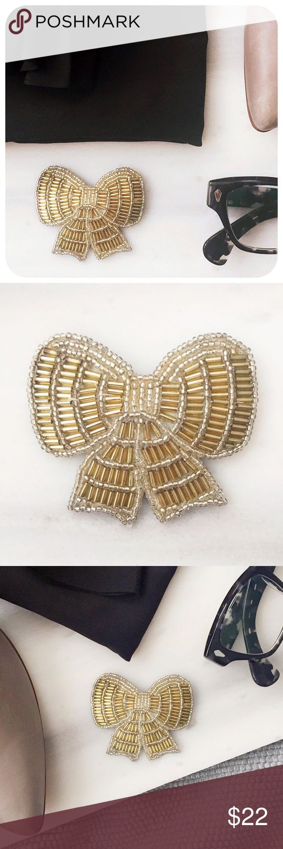"{{ Vintage }} 1988 Avon Beaded Ribbon Bow Brooch Vintage Avon bow shaped brooch with silver and gold glass seed and bugle beads circa 1980s.   {{ CONDITION }} Excellent - minor scratch on back  {{ MEASUREMENTS }} Width - 2.5"" Height - 2.25""  {{ TAGS }} preppy beaded pin formal metallic hipster cute sophisticated feminine pretty girly flirty costume jewelry accessory geek chic quirky winter gift artsy present cocktail party kitsch cool valentine's day date badge metallic spring  {{ IF YOU…"