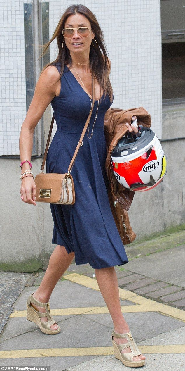 Suns out, shades on! Melanie Sykes rocks some tinted sunglasses to finish off her outfit...