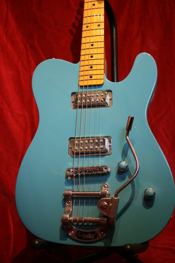 This is a swamp ash Telecaster** body routed to accommodate a pair of overwound Gretsch pickups.    The neck pocket has been re-cut to tilt the 50's profile neck back at an angle that allows the use of a fully adjustable T-O-M style bridge, mated to a B50 tremolo tailpiece fitted with a Chet style arm. Custom paint.