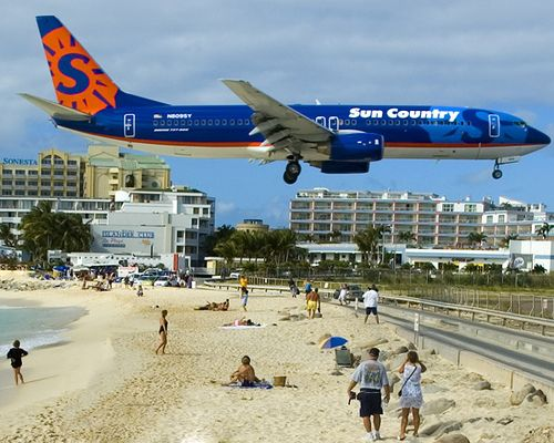 Planes landing at the Princess Juliana Airport, St. Maarten - Sun Country.