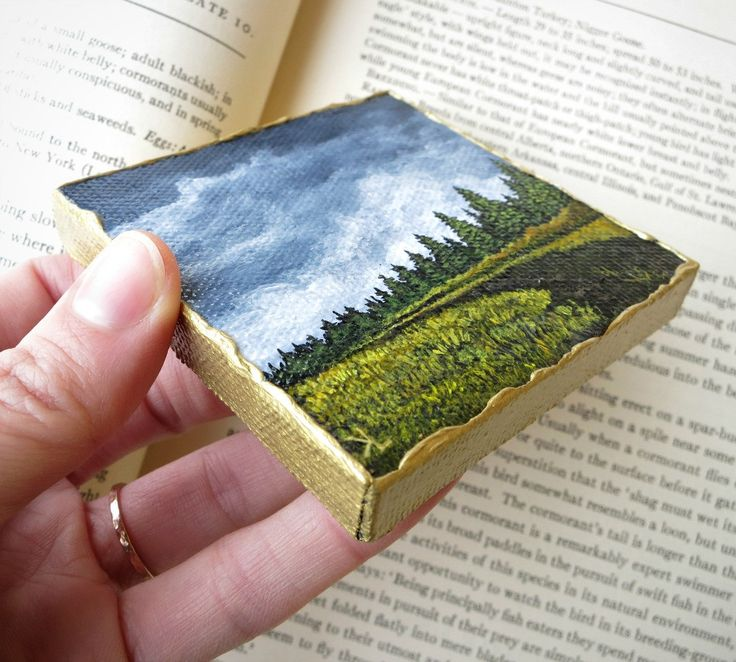 This late autumn landscape painting features a distant pine forest set against a dark sky. Though only slightly larger than a business card, miniature paintings can make quite an impact and are a plea