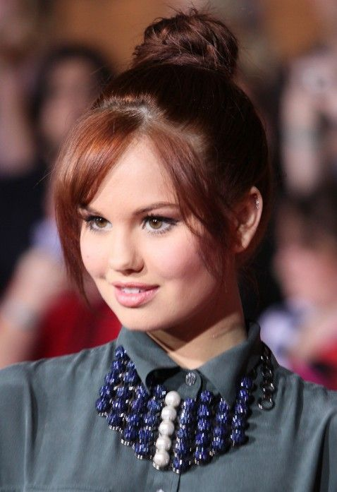 top knot with bangs   Debby Ryan Cute Top Knot Hair Style for All Ages   Hairstyles Weekly