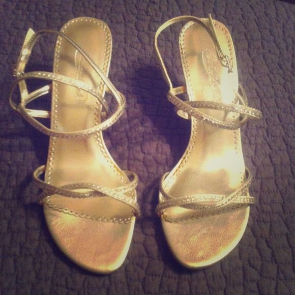 Silver Strappy Sandals Silver rhinestoned sandals with crisscrossed straps! Only worn once to an outdoor wedding, so they aren't in perfect condition but still look great! Shoes Sandals