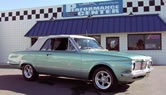 The aqua-marine paint, white convertible top and American Racing rims make this JBA-built 1964 Plymouth Valiant a visual standout