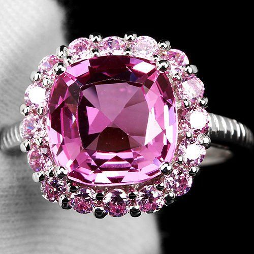 This is a gorgeous 3.4CT cushion cut pink sapphire halo engagement or promise ring. Wear it for red carpet or vow renewal. Vintage and size 7 only. - Ring Size: 7 - Main Stone: Sapphire - Metal Purity