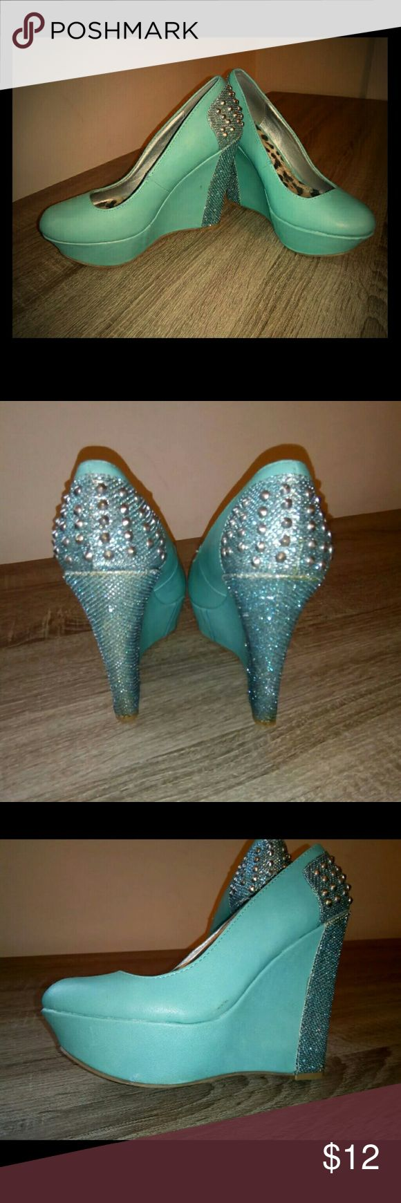 Teal wedges Teal platform wedges with sparkle back accent. Size 7. Few minor scratches from wear.  No reasonable offer refused!  Bundle and save!! Thanks for looking! :-) Shoes Wedges