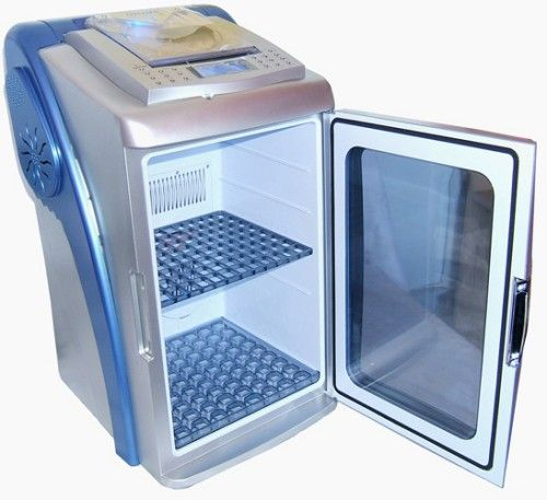 It's a cool mini fridge BUT WAIT, there's more! CD player, alarm clock, iPod input, blue lights. Whoa...