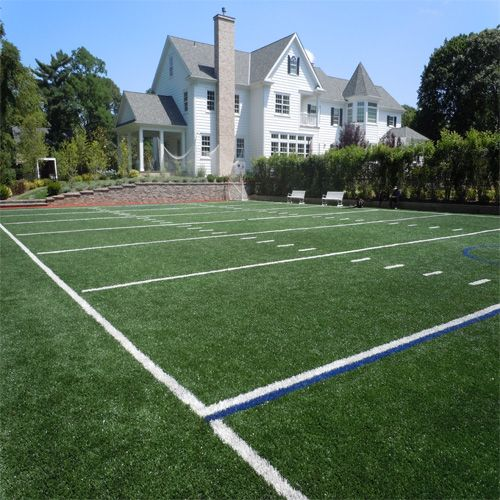 My son would go nuts for this football/lacrosse field backyard.
