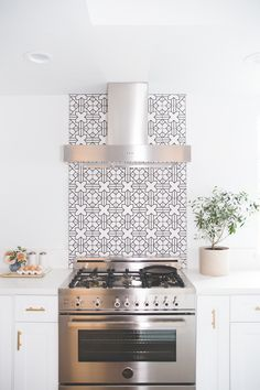 """chic kitchen backsplash using hand-painted """"Kasbah Trellis"""" tiles by Fireclay"""