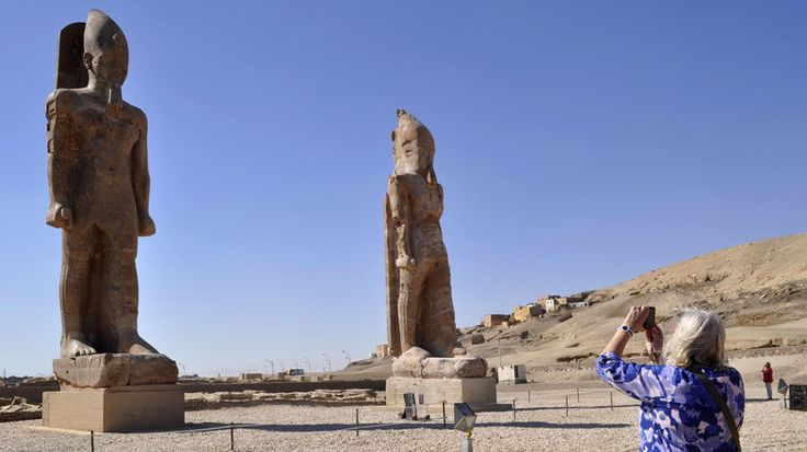 Archaeologists on Sunday unveiled a restored colossal statue of Amenhotep III that was toppled in an