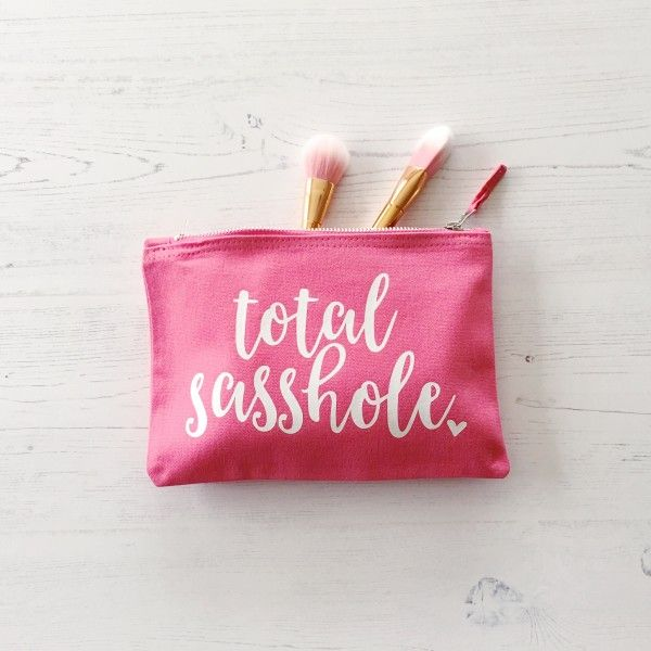 A hot pink wash bag with chrome zipper, perfect gift for the sassiest person you know! Design on the front is white vinyl, it has been sealed on using heat