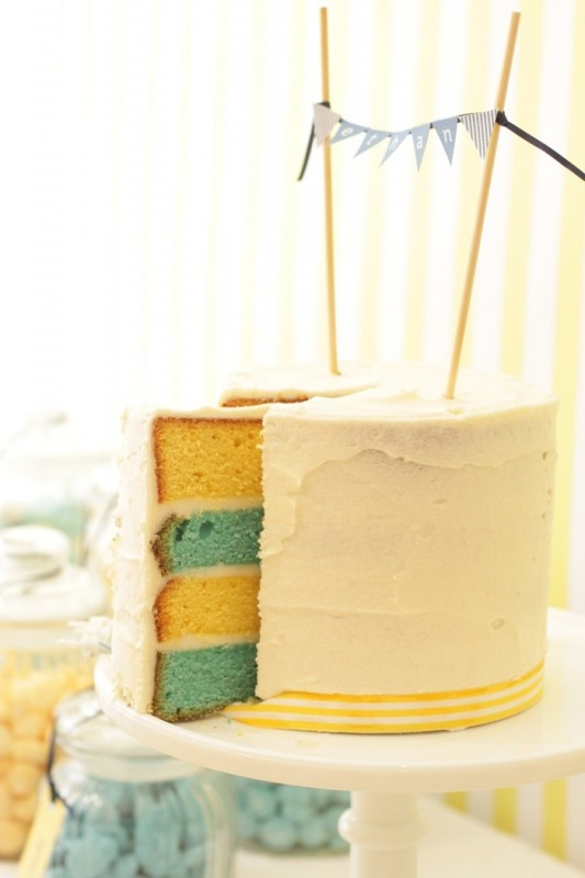 cake bunting with matching cake layers. ribbon around bottom of cake.