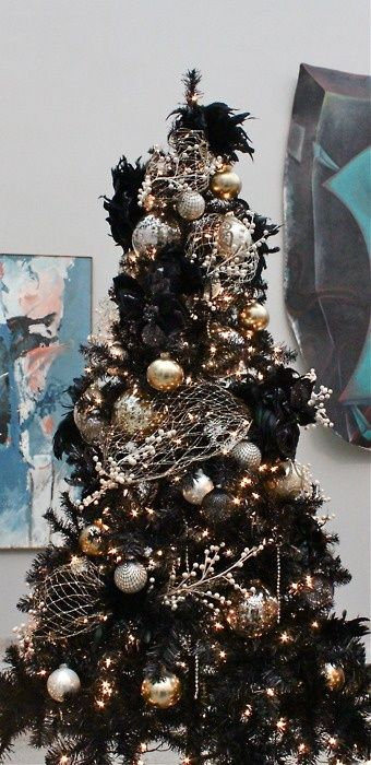 Black, white, gold & silver Christmas tree, dont mix in trad colours for decor