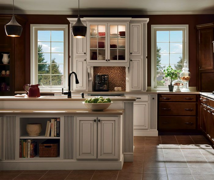 Kitchen With Light Cabinets And Dark Walls