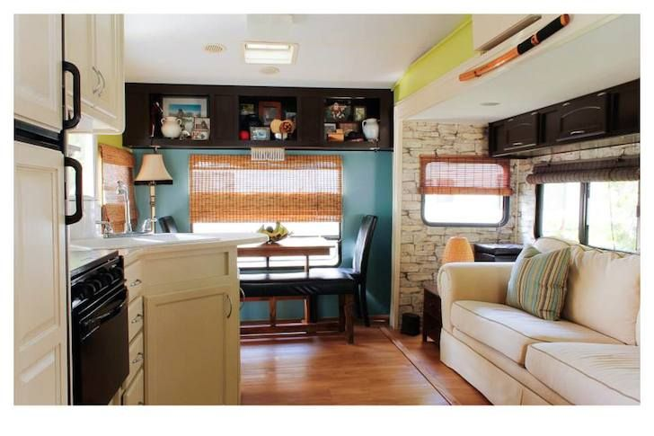 Laura Sauvé is a décor consultant from Milton, Ontario, Canada. Along with her partner Chad, she renovated and winterized a 30 foot long 5th wheel trailer.