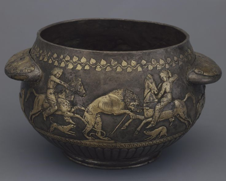 Bowl with a Depiction of Lion Hunting. Place: Russia (now Ukraine). Epoch. Period: Early Iron Age. Date: Scythian Culture. Early 4th century BC. Place of finding: Solokha Barrow. Entrance Grave. Archaeological site: Dnieper Area, Zaporozhye Region. Material: gold.