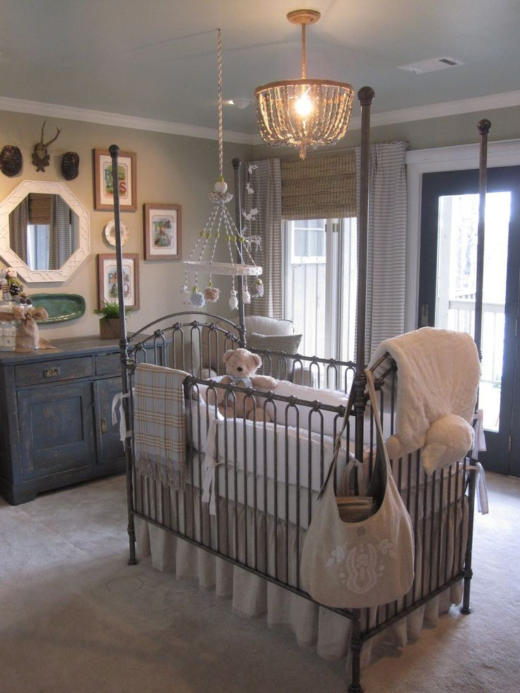 Love everything about this room, it's very different having the crib in the middle of the room but super cute.