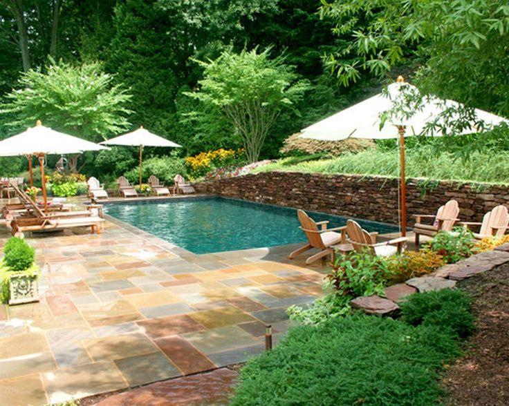 backyard pool with retaining wall