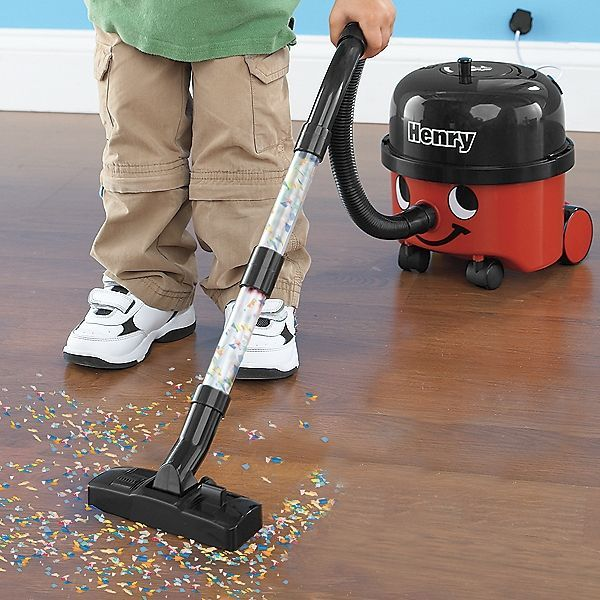 """Little Henry Vacuum!  Kids love cleanin' up with their very own toy """"shop vac!"""" So realistic (not to mention adorable), it actually picks up tiny particles! Looks just like yours, with a retractable cord, front swivel wheels, removable collection tank, and faux """"wall plug"""" (it's a clever suction cup). #stepstoowningadaycare"""