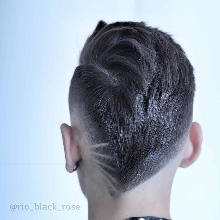 The neckline hair design trend just keeps getting bigger. Building on the current hair tattoo trend, this version relocates the design from the sides to the back of the head for an eye-catching rear view. The neckline hair