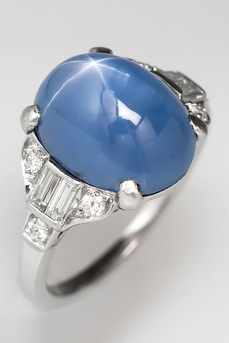 A stunning 1930's Art Deco star sapphire ring in platinum and diamonds.