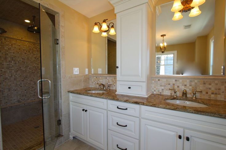 Traditional Master Bathroom with Raised panel, Inset cabinets, Complex granite counters, Rain Shower Head, Stone Tile