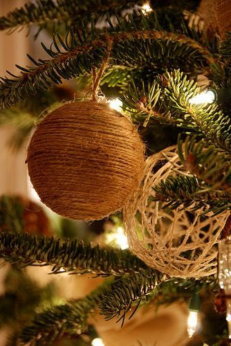 DIY tree decorations either using twine wrapped and glued around styrofoam ball and/or twine wrapped around a balloon-then popped