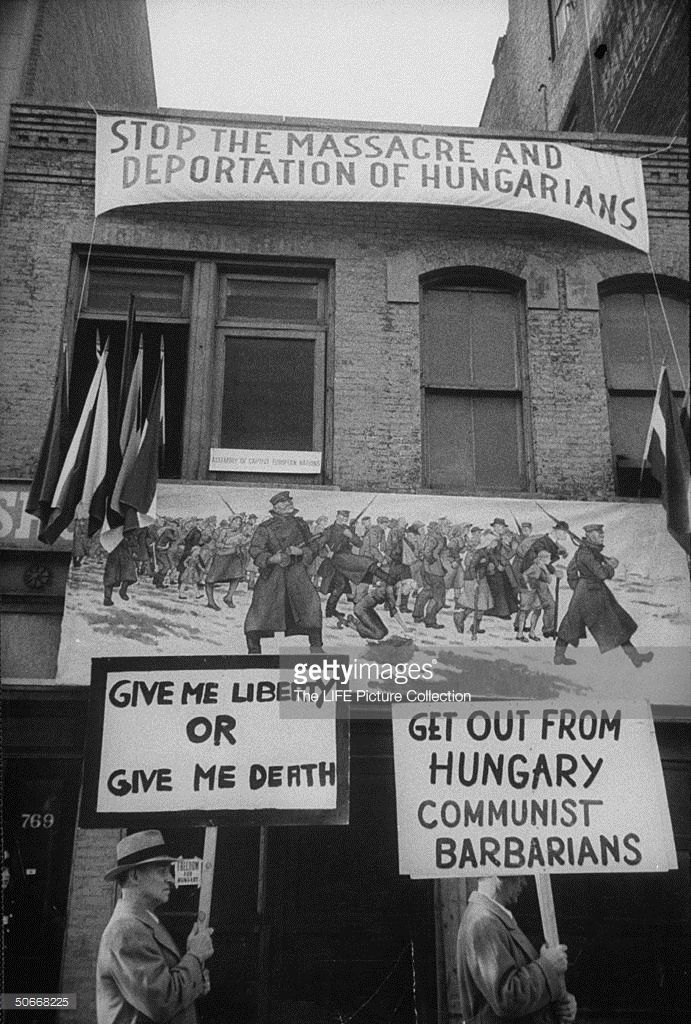 1956: Picket lines at Russian legation with signs and pictures about Russian tyranny at Budapest re Hungarian Revolution.