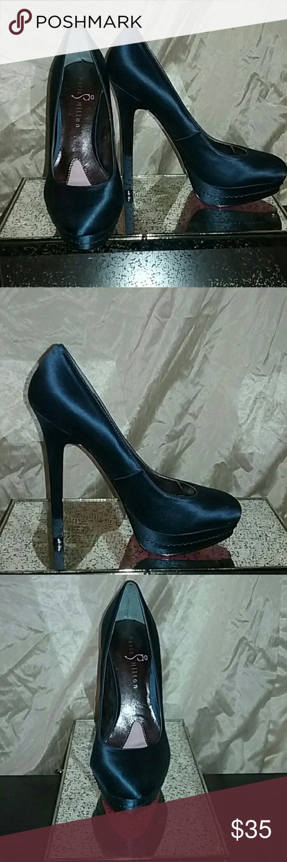 Pairs hilton heels Never been worn (only tried them on)  Paris Hilton navy Staten heels.Size 7 basically brand-new. Paris Hilton Shoes Heels