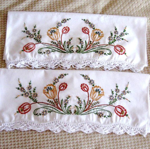 Vintage embroidered pillow cases floral orange green brown new old stock unused. Intricate, elaborate and extensive embroidery filling up about ¼ of