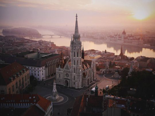 "a real ""Wow"" aerial shot of Matthias Church, the Fisherman's Bastion, the Danube, Margaret Island and the Parliament."