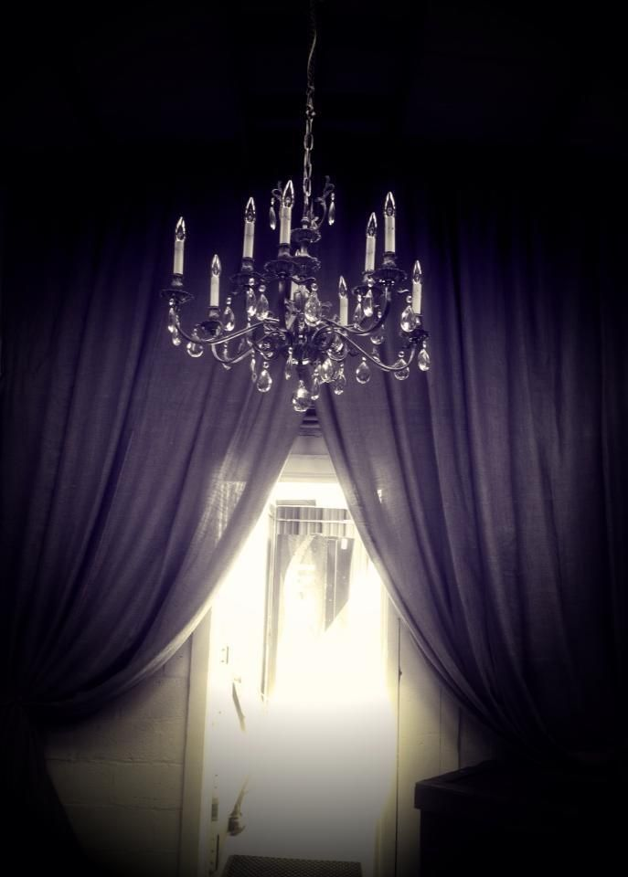 Like the chandelier and dark curtains