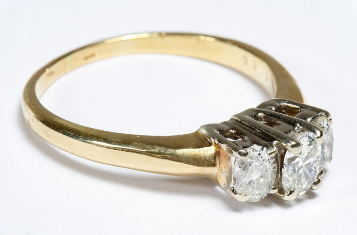 "Lot 232: 14k Gold and Diamond Ring; Having three oval cut diamonds; marked ""14k"" inside band"