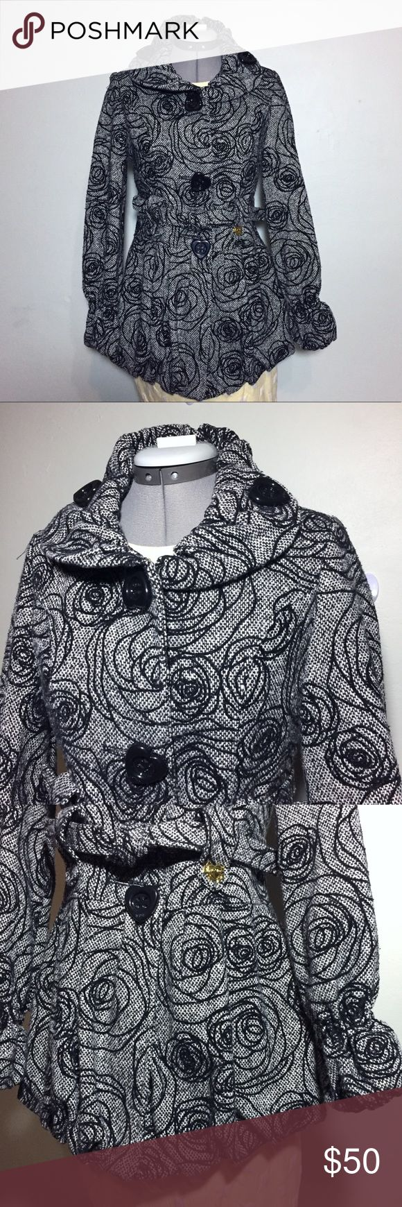 """Betsey Johnson Black Embroidered Rose Tweed Coat 2 Amazing Betsey Johnson Black Rose Embroidered Tweed Coat. Has a ballooned hem and Wrists, with belted waist and heart buttons. Absolutely gorgeous and flattering. Size 2 measures flat approximately: 15"""" across shoulders, 17"""" across chest, 15"""" across waist, 28"""" long, 24"""" sleeve, skirted wide bottom. 35% acrylic, 25% wool, 25% poly, 15% nylon. Fully lined 100% poly. Awesome pink lining. Dry Clean. 1230/10/011618 winter warm outerwear fun…"""