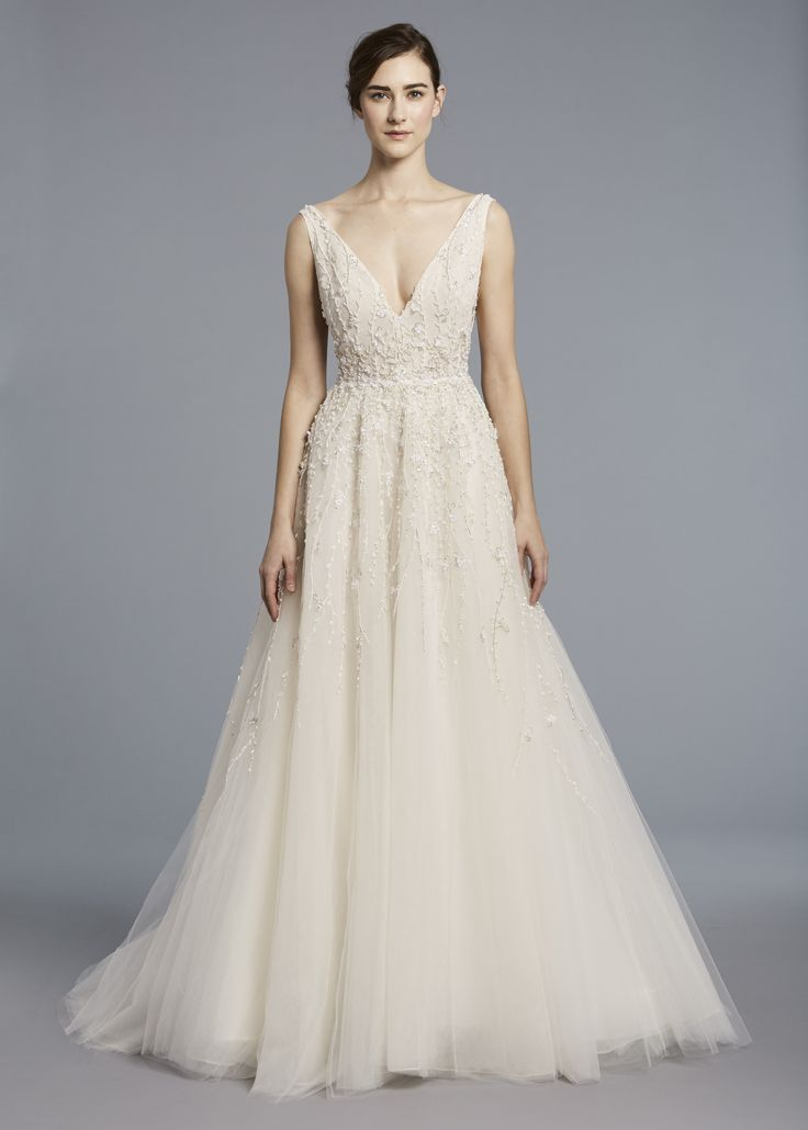 FRNCOISE  - Anne Barge, Spring 2018 | V-neck wedding gown heavily embellished with beading from bodice onto full skirt of tulle.