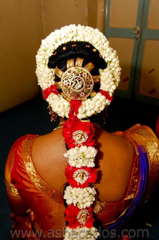unbelievably ornate flower garland around a bejewelled bun, and beautifully braided and flower bedecked plait. . this hair is so traditionally Indian and so devestatingly beautiful for this bride!