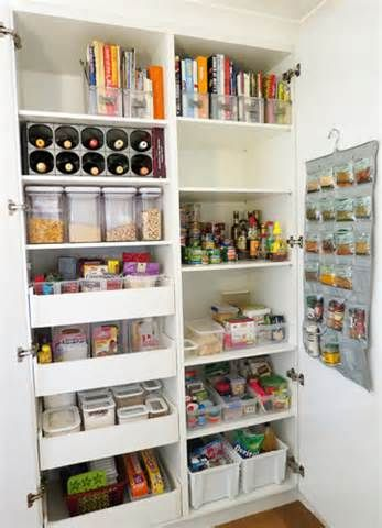 Pantry- nice idea with space for cook books and magazines. Everything nicely organized.
