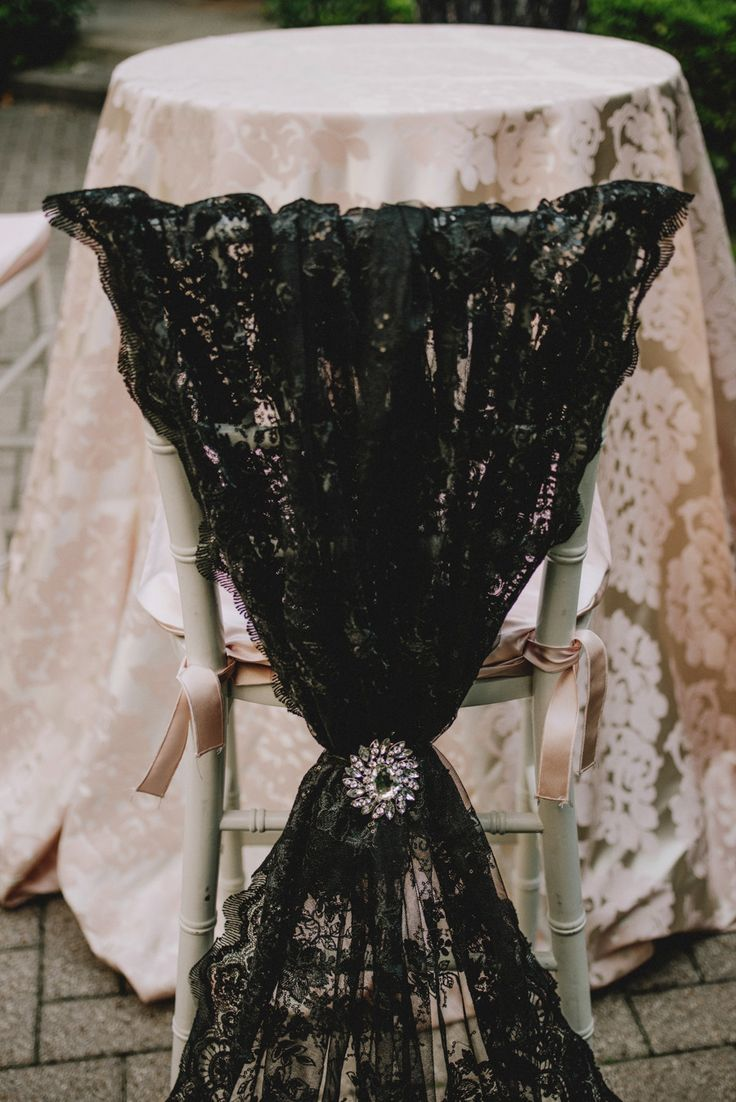 Pink lace linen and black lace chair decor.  EB Inc. Photography: Joseph West Photography - www.josephwashere.com  Read More: http://www.stylemepretty.com/southwest-weddings/2014/03/06/blush-inspiration-shoot/